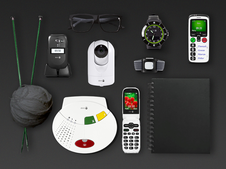 Doro Care social alarms, GPS watch and mobile phones on black background