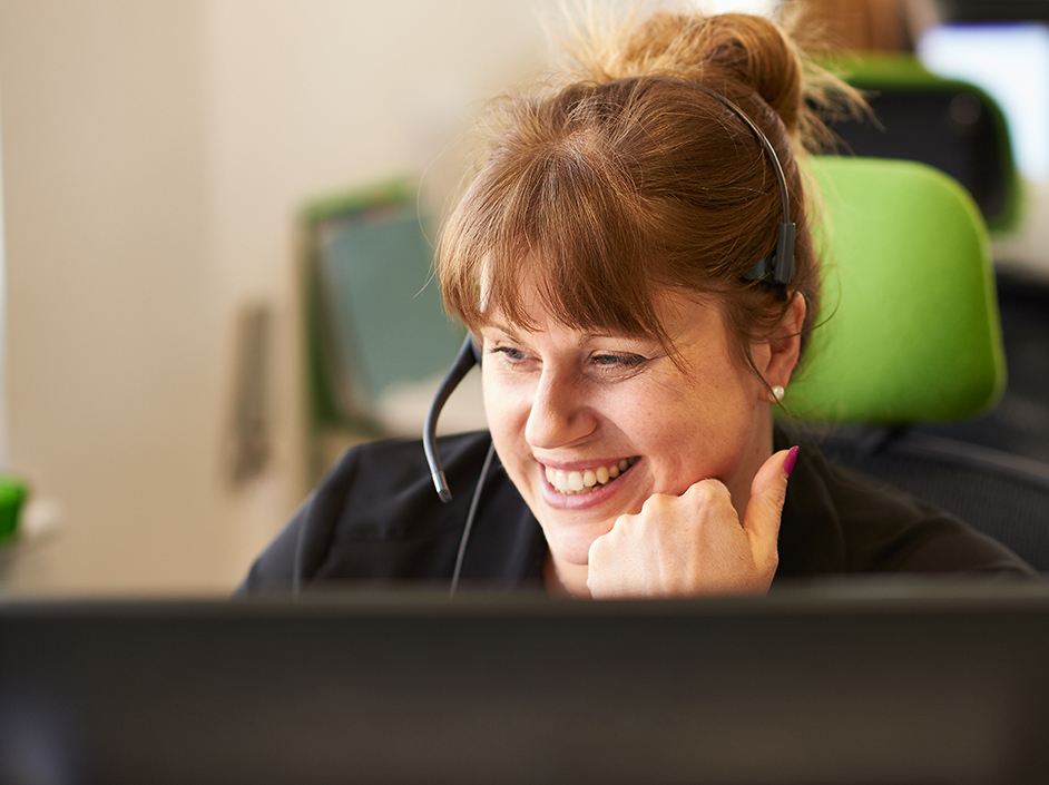 Young woman in alarm receiving centre smiling