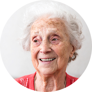 Senior woman in red jumper smiling