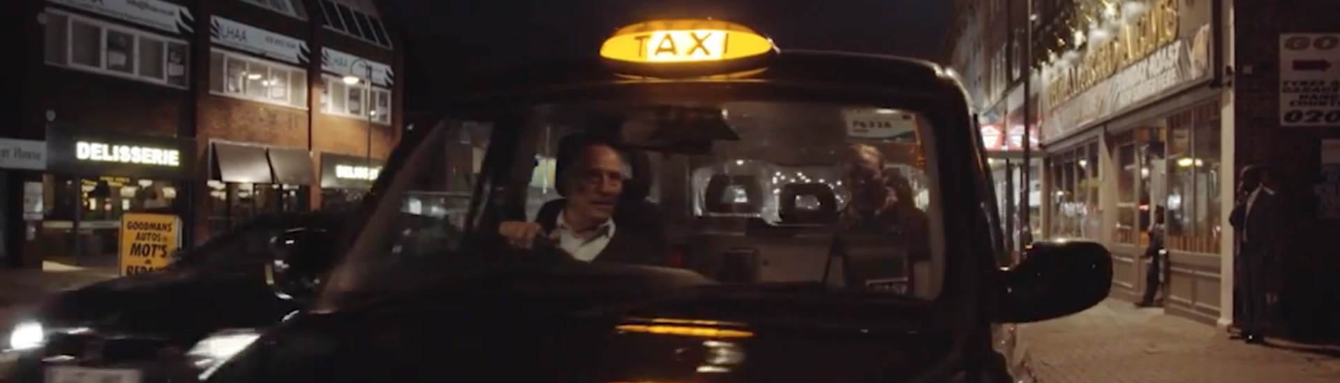 Taxi driver receiving payment.